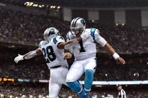 NEW ORLEANS, LA - DECEMBER 06: Cam Newton #1 celebrates a touchdown with Jonathan Stewart #28 of the Carolina Panthers during the second quarter of a game against the New Orleans Saints at the Mercedes-Benz Superdome on December 6, 2015 in New Orleans, Louisiana. (Photo by Stacy Revere/Getty Images)