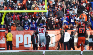 Nov 27, 2016; Cleveland, OH, USA; New York Giants defensive end Jason Pierre-Paul (90) returns an interception for a touchdown during the second half against the Cleveland Browns at FirstEnergy Stadium. Mandatory Credit: Ken Blaze-USA TODAY Sports
