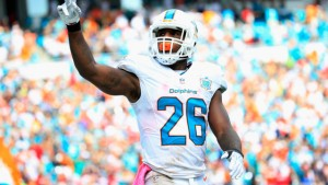 MIAMI GARDENS, FL - OCTOBER 25:  Lamar Miller #26 of the Miami Dolphins celebrates his touchdown in the second quarter against the Houston Texans at Sun Life Stadium on October 25, 2015 in Miami Gardens, Florida.  (Photo by Chris Trotman/Getty Images)