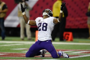 Nov 29, 2015; Atlanta, GA, USA; Minnesota Vikings running back Adrian Peterson (28) reacts after scoring a touchdown against the Atlanta Falcons during the fourth quarter at the Georgia Dome. The Vikings defeated the Falcons 20-10. Mandatory Credit: Dale Zanine-USA TODAY Sports